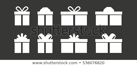 Woman offering Christmas gift in wrapped box Stock photo © stevanovicigor