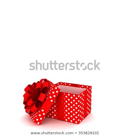 white polka dot present box with red bow Stock photo © tetkoren