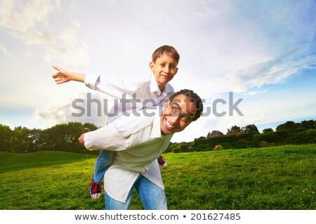 African man and son at sunset Stock photo © adrenalina