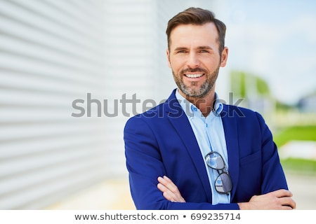 Portrait of a handsome middle-age man smiling with sunglasses, Stock photo © alexandrenunes