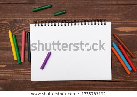 Książek kredki odizolowany biały papieru niebieski Zdjęcia stock © cherezoff