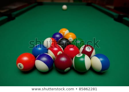 billiards balls with motion on a green pool table stock photo © frankljr