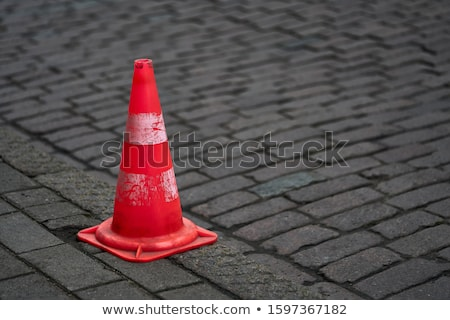 Road sign and traffic cone Stock photo © Oakozhan