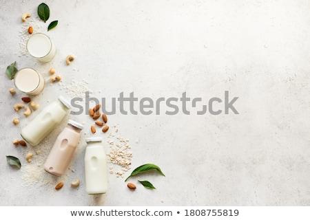 mandula · tej · üveg · üveg · diók · vízszintes - stock fotó © Karpenkovdenis