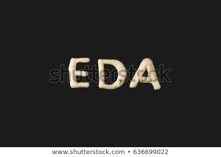 top view of word eda made from cookie dough isolated on black Stock photo © LightFieldStudios