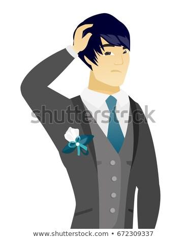 Young asian groom scratching his head. Stock photo © RAStudio