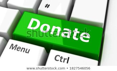 Green Donate Key on Keyboard. 3D. Stock photo © tashatuvango