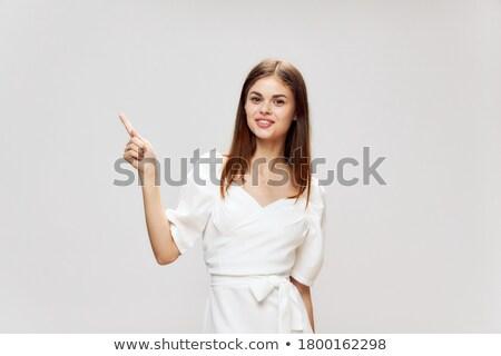 Brunette in White Dress on white background Stock photo © filipw