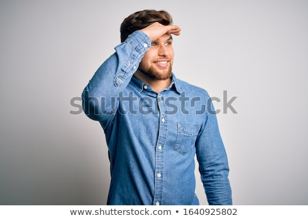 Portrait of a young casual man looking far away Stock photo © deandrobot