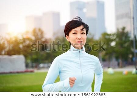 Jogging Szingapúr naplemente nő fut bemozdulás Stock fotó © joyr