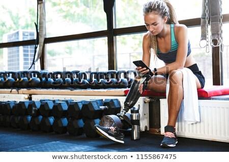 無効になって スポーツ 女性 座って ジム 携帯電話 ストックフォト © deandrobot