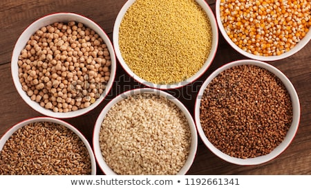 Whole foods diet base - various seeds in bowls on brown table, c Stock photo © lightkeeper