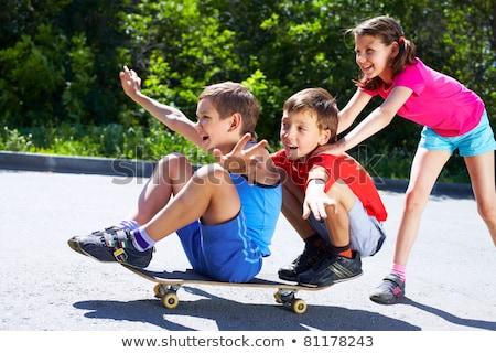 Bonitinho patinador menino posando parque Foto stock © acidgrey