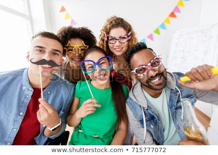 happy friends with party props stock photo © dolgachov