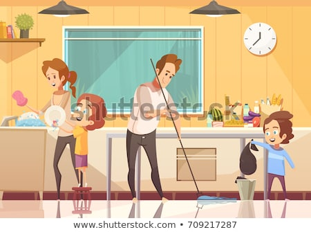 sister cleaning dishes in kitchen stock photo © colematt