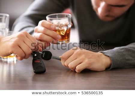 drunk driver hand taking car key from table stock photo © dolgachov