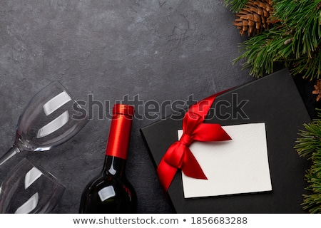 christmas card with champagne gift and fir tree stock photo © karandaev