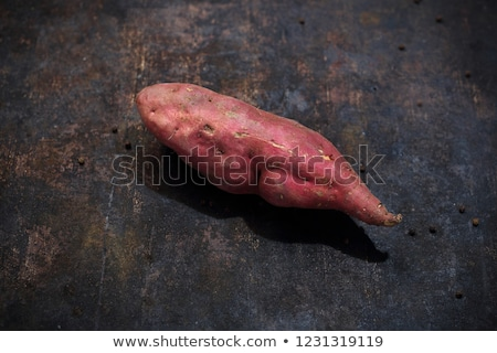 Fresh organic sweet potato on dark background. stock photo © szefei