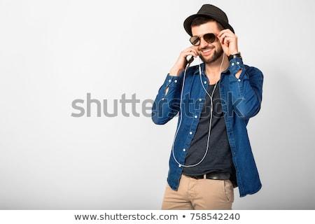 derűs · fiatal · fickó · napszemüveg · mutat · izolált - stock fotó © deandrobot