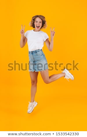 Full length photo of attractive blond woman in basic clothing ju Stock photo © deandrobot