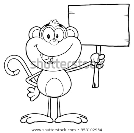black and white smiling monkey cartoon character holding up a blank wood sign stock photo © hittoon