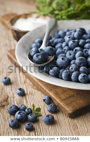 Fresh blueberries on a vintage plate on a table Stock photo © madeleine_steinbach