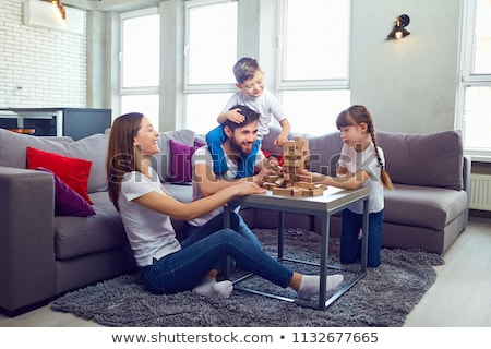 Happy family playing at home. Stock photo © choreograph