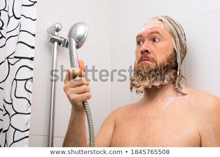 man waiting for water to come out of a tap Stock photo © nito