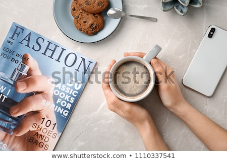 young woman is laying on a table breakfast table with coffee fruit and bread croisant on a balcony stockfoto © galitskaya