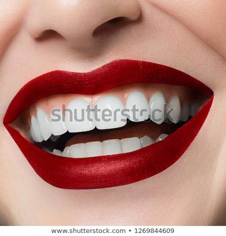 Close-up happy female smile with healthy white teeth, bright magenta lips make-up. Cosmetology, dent Stock photo © serdechny