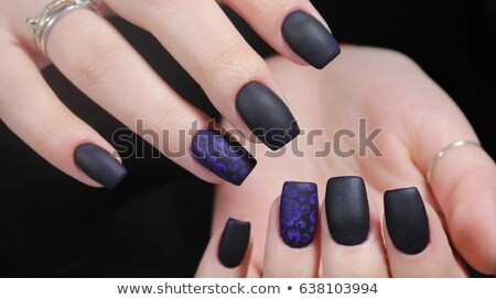Stock photo: Black matte nail polish. Manicured nail with black matte nail po