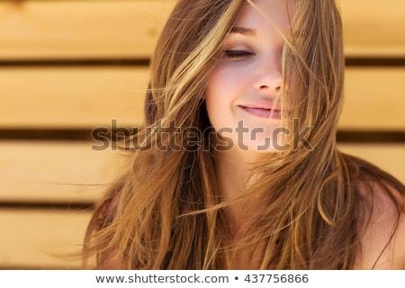 szépség · portré · tinilány · puha · bőrápolás · lefelé · néz - stock fotó © serdechny