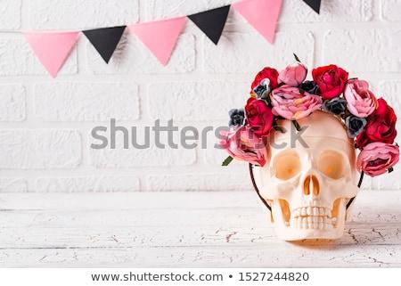 Koponya tál rózsaszín virág dekoráció rózsaszín halloween Stock fotó © furmanphoto