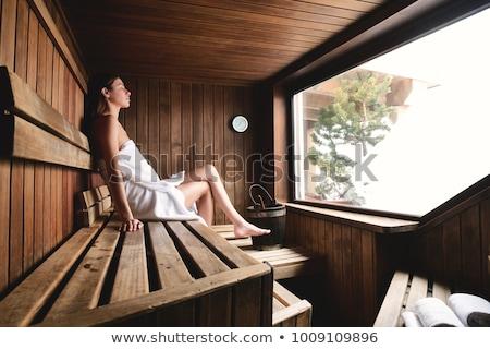 Hermosa rubio mujer relajante sauna jóvenes Foto stock © boggy