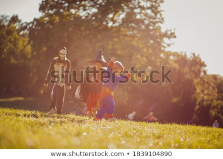 A boy and a girl brother and sister of preschool age walk in winter in a snow covered forest with tr Stock photo © ElenaBatkova