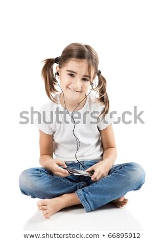 Bambina ascoltare musica lettore mp3 isolato bianco Foto d'archivio © Lopolo