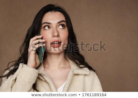 Foto sedutor mulher celular Foto stock © deandrobot