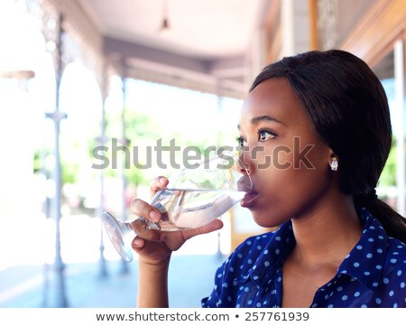 closeup portrait of young business woman drinking water with nat stock photo © hasloo
