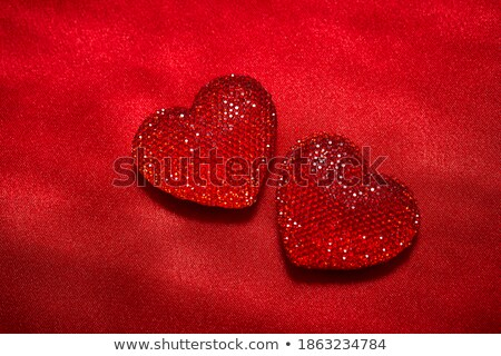 Red heart on silky wavy fabric Stock photo © tish1