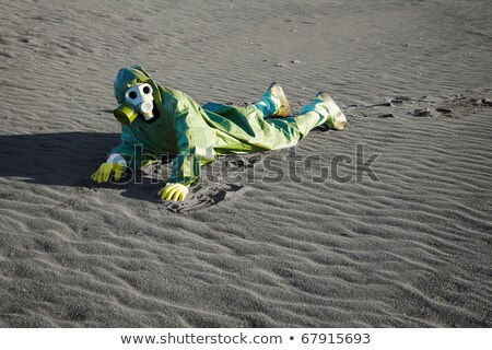 Man in gas masks crawling on poisoned soil Stock photo © pzaxe