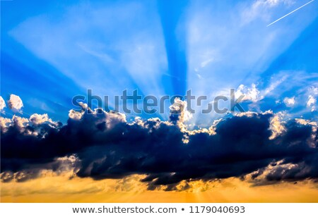 Blue and dark sky behind stormy clouds Stock photo © ziprashantzi