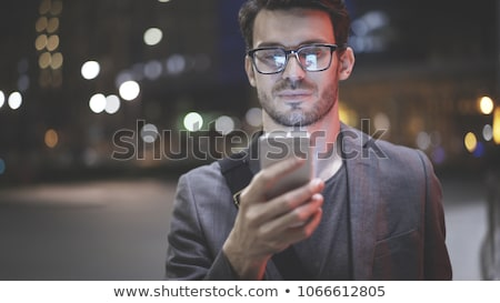 Serious businessman holding a mobile phone Stock photo © photography33