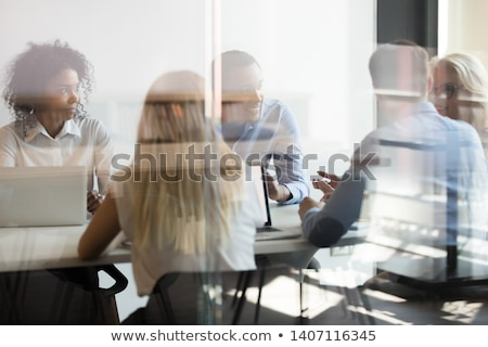 Image of executive reflected in glass Stock photo © photography33