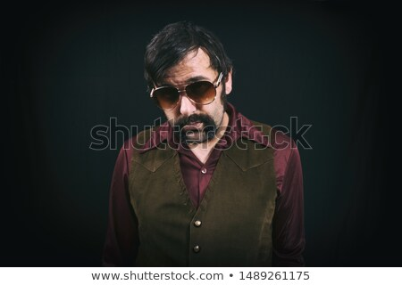 sleazy guy with sunglasses stock photo © sumners