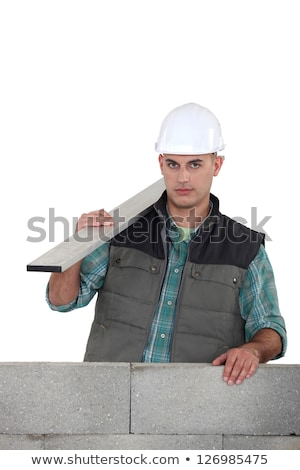 Builder stood by uncompleted wall Stock photo © photography33