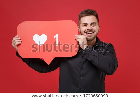 young man holding red heart stock photo © photography33