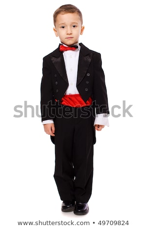 Poważny młody chłopak czarny garnitur studio portret Zdjęcia stock © ElinaManninen