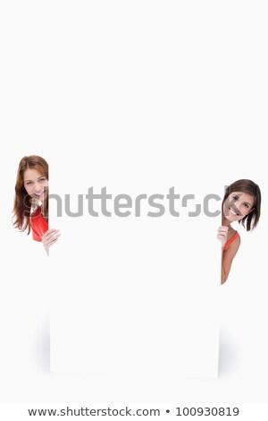 Tieners verbergen achter poster uit kant Stockfoto © wavebreak_media