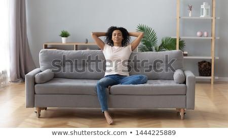 женщину · только · диван · портрет · стороны · улыбка - Сток-фото © vwalakte