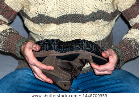 casual man shows foot sole Stock photo © feedough